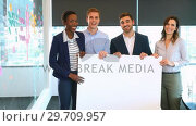 Купить «Portrait of business colleagues holding a blank banner 4k», видеоролик № 29709957, снято 19 августа 2017 г. (c) Wavebreak Media / Фотобанк Лори