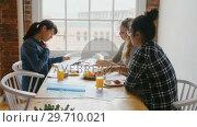 Купить «Businesswomen discussing over documents while having breakfast 4k», видеоролик № 29710021, снято 9 июля 2017 г. (c) Wavebreak Media / Фотобанк Лори