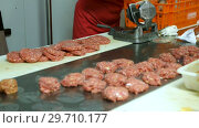 Process cooking meat production for sale in butcher's shop. Стоковое видео, видеограф Яков Филимонов / Фотобанк Лори