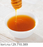 Купить «honey on white wooden table», фото № 29710389, снято 2 сентября 2018 г. (c) Майя Крученкова / Фотобанк Лори
