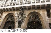 Купить «Facade of Guell Palace by Antoni Gaudi», видеоролик № 29710557, снято 2 сентября 2018 г. (c) Яков Филимонов / Фотобанк Лори