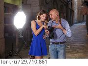Купить «Photographer talking to cheerful female model», фото № 29710861, снято 5 октября 2018 г. (c) Яков Филимонов / Фотобанк Лори