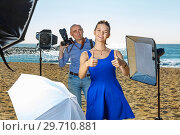 Купить «Young attractive female model delighted with professional photo», фото № 29710881, снято 5 октября 2018 г. (c) Яков Филимонов / Фотобанк Лори