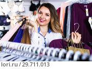 Купить «Female shopper boasting her purchases in underwear shop», фото № 29711013, снято 20 марта 2017 г. (c) Яков Филимонов / Фотобанк Лори