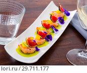 Купить «Ceviche from pickled red fish and cumquat a circle of kiwi, with figs at plate», фото № 29711177, снято 19 апреля 2019 г. (c) Яков Филимонов / Фотобанк Лори