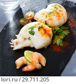 Купить «Roasted sepia served with shrimps», фото № 29711205, снято 18 января 2019 г. (c) Яков Филимонов / Фотобанк Лори