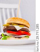 Купить «Delicious tasty burger with beef cutlet, fresh vegetables and cheese», фото № 29711285, снято 14 января 2019 г. (c) Яков Филимонов / Фотобанк Лори