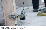 Купить «Construction site. The hook of industrial crane hooked to the wooden part on the construction», видеоролик № 29711397, снято 20 марта 2019 г. (c) Константин Шишкин / Фотобанк Лори