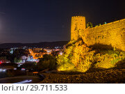 Illuminated tower of Rabat fortress on  background of the night city (2018 год). Редакционное фото, фотограф Юлия Бабкина / Фотобанк Лори
