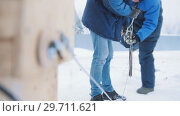 Купить «Construction site. Man workers using the tensioner for the cargo», видеоролик № 29711621, снято 20 сентября 2019 г. (c) Константин Шишкин / Фотобанк Лори