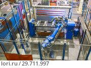Купить «Welding robot in the process. Modern welding production.», фото № 29711997, снято 28 сентября 2018 г. (c) Андрей Радченко / Фотобанк Лори