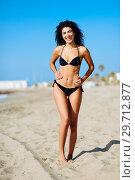 Купить «Young arabic woman with beautiful body in swimwear smiling on a tropical beach.», фото № 29712877, снято 24 сентября 2017 г. (c) Ingram Publishing / Фотобанк Лори
