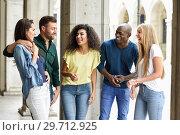 Купить «Multi-ethnic group of friends having fun together in urban background», фото № 29712925, снято 23 апреля 2017 г. (c) Ingram Publishing / Фотобанк Лори