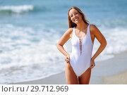 Купить «Blond woman with beautiful body in swimswit on a tropical beach», фото № 29712969, снято 24 сентября 2017 г. (c) Ingram Publishing / Фотобанк Лори