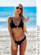 Купить «Blond woman in swimwear on the beach with aviator sunglasses», фото № 29713021, снято 24 сентября 2017 г. (c) Ingram Publishing / Фотобанк Лори