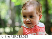 Купить «Six months old baby girl smiling outdoors.», фото № 29713025, снято 4 августа 2011 г. (c) Ingram Publishing / Фотобанк Лори