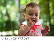 Купить «Six months old baby girl having fun outdoors.», фото № 29713029, снято 4 августа 2011 г. (c) Ingram Publishing / Фотобанк Лори