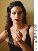 Купить «Young woman in black lingerie smoking cigarette», фото № 29713061, снято 28 ноября 2017 г. (c) Ingram Publishing / Фотобанк Лори