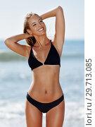 Купить «Young blonde woman with beautiful body in swimwear smiling on a tropical beach. », фото № 29713085, снято 24 сентября 2017 г. (c) Ingram Publishing / Фотобанк Лори