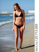Купить «Young blonde woman with beautiful body in swimwear on a tropical beach. », фото № 29713089, снято 24 сентября 2017 г. (c) Ingram Publishing / Фотобанк Лори