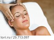 Купить «Young woman receiving a head massage in a spa center.», фото № 29713097, снято 23 августа 2017 г. (c) Ingram Publishing / Фотобанк Лори