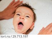 Купить «Baby girl two months old yawning», фото № 29713197, снято 17 апреля 2011 г. (c) Ingram Publishing / Фотобанк Лори