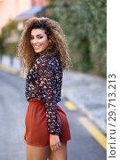 Купить «Happy young arabic woman with black curly hairstyle.», фото № 29713213, снято 21 января 2018 г. (c) Ingram Publishing / Фотобанк Лори