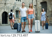 Купить «Active man and woman in shorts with luggage», фото № 29713497, снято 22 июня 2017 г. (c) Яков Филимонов / Фотобанк Лори