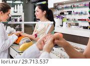Купить «positive female manicurist filing and shaping nails in beauty salon», фото № 29713537, снято 28 апреля 2017 г. (c) Яков Филимонов / Фотобанк Лори