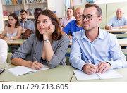 Купить «Students mixed age listening task for exam», фото № 29713605, снято 28 июня 2018 г. (c) Яков Филимонов / Фотобанк Лори