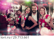 Купить «Man with female friends on Hawaiian party in bar», фото № 29713661, снято 29 ноября 2017 г. (c) Яков Филимонов / Фотобанк Лори