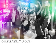 Купить «Cheerful guy expressively dancing partying in bar», фото № 29713669, снято 29 ноября 2017 г. (c) Яков Филимонов / Фотобанк Лори