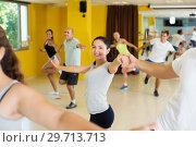 Купить «Dancing couples enjoying active swing», фото № 29713713, снято 21 июня 2017 г. (c) Яков Филимонов / Фотобанк Лори