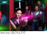 Купить «Lucky girl took aim and having fun with friends», фото № 29713717, снято 23 августа 2018 г. (c) Яков Филимонов / Фотобанк Лори