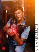 Купить «guy took aim colored laser guns during laser tag game», фото № 29713745, снято 23 августа 2018 г. (c) Яков Филимонов / Фотобанк Лори