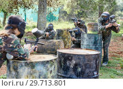 Купить «Team of adult people playing paintball on battlefield outdoor, running with guns», фото № 29713801, снято 22 сентября 2018 г. (c) Яков Филимонов / Фотобанк Лори