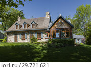 Купить «Old (circa 1740) Canadiana fieldstone cottage style home facade with new extension in spring, Quebec, Canada. This image is released for book, calendar...», фото № 29721621, снято 24 мая 2016 г. (c) age Fotostock / Фотобанк Лори