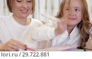 Купить «Close-up - Charming Mother And Daughter Drawing Together», видеоролик № 29722881, снято 20 мая 2019 г. (c) Pavel Biryukov / Фотобанк Лори