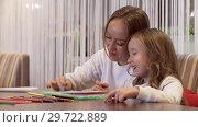 Купить «Positive Young Woman Is Drawing With Her Little Beautiful Daughter», видеоролик № 29722889, снято 20 мая 2019 г. (c) Pavel Biryukov / Фотобанк Лори