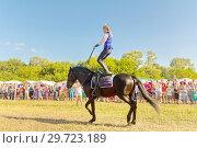 Купить «Russia, Samara, July, 2018: a Cossack girl rides a horse and performs tricks.», фото № 29723189, снято 29 июля 2018 г. (c) Акиньшин Владимир / Фотобанк Лори