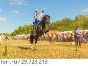 Купить «Russia, Samara, July, 2018: a Cossack girl rides a horse and performs tricks.», фото № 29723213, снято 29 июля 2018 г. (c) Акиньшин Владимир / Фотобанк Лори