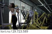 Купить «Beautiful Young Woman Aspiring Athlete Does Squats», видеоролик № 29723589, снято 20 мая 2019 г. (c) Pavel Biryukov / Фотобанк Лори