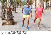 Купить «Couple running outdoors», фото № 29723721, снято 26 июня 2018 г. (c) Яков Филимонов / Фотобанк Лори