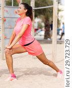 Купить «Woman training on outdoors fitness station», фото № 29723729, снято 26 июня 2018 г. (c) Яков Филимонов / Фотобанк Лори