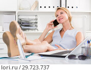 Купить «Portrait of blond adult girl in office talk on telephone», фото № 29723737, снято 15 июня 2017 г. (c) Яков Филимонов / Фотобанк Лори