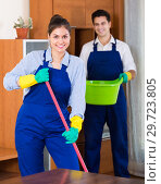 Купить «cleaners in overalls with supplies», фото № 29723805, снято 16 января 2019 г. (c) Яков Филимонов / Фотобанк Лори