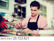 Купить «Joiner working in workshop», фото № 29723821, снято 8 апреля 2017 г. (c) Яков Филимонов / Фотобанк Лори