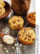 Купить «Diet oat muffins with raisins», фото № 29723829, снято 3 апреля 2018 г. (c) Надежда Мишкова / Фотобанк Лори