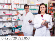 Купить «Portrait of two friendly pharmacists working», фото № 29723853, снято 19 апреля 2019 г. (c) Яков Филимонов / Фотобанк Лори