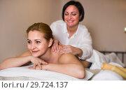 Купить «Young girl is happy with procedure massage in beauty parlor», фото № 29724137, снято 7 марта 2017 г. (c) Яков Филимонов / Фотобанк Лори